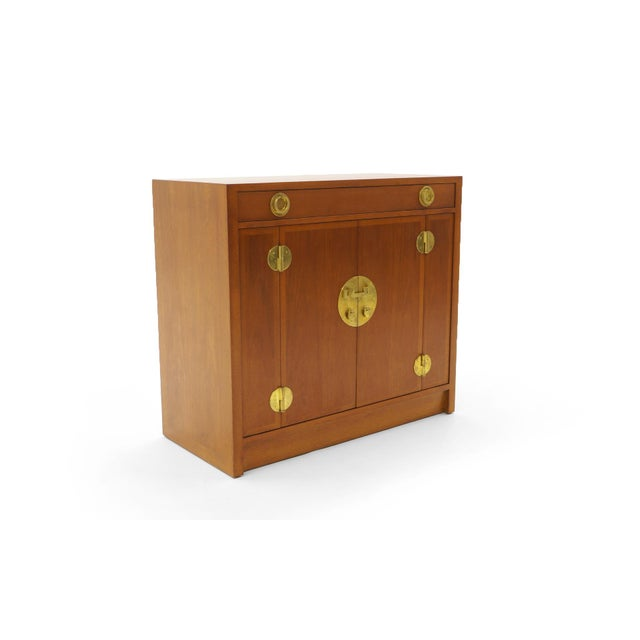 Storage chest or cabinet designed by Edward Wormley for Dunbar. Expertly refinished mahogany case with solid brass...