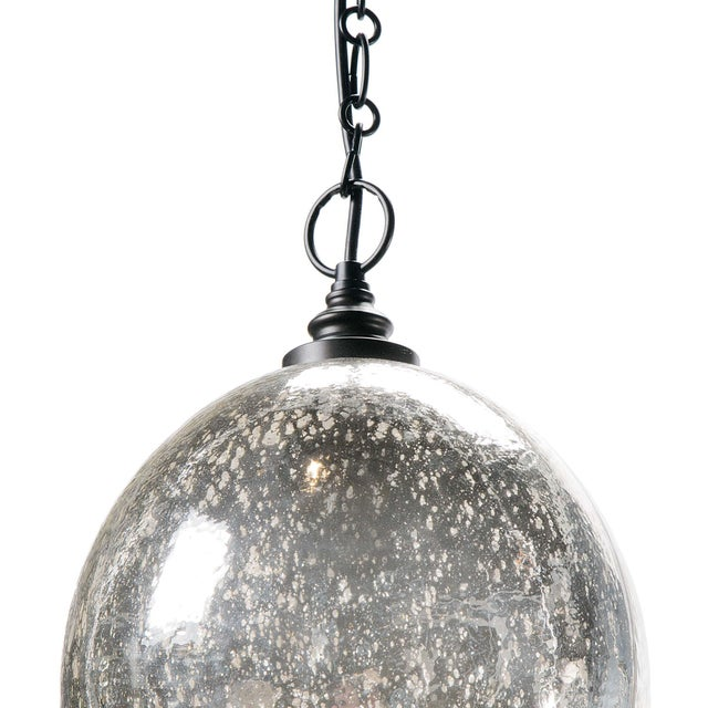 Glass with an Antique Mercury finish forms the dome shade of the Glass Float pendant. Black hardware makes for a chic...