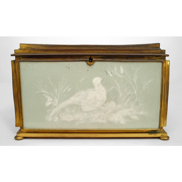 French Victorian green and white pate sur pate porcelain rectangular shaped box with bird design.
