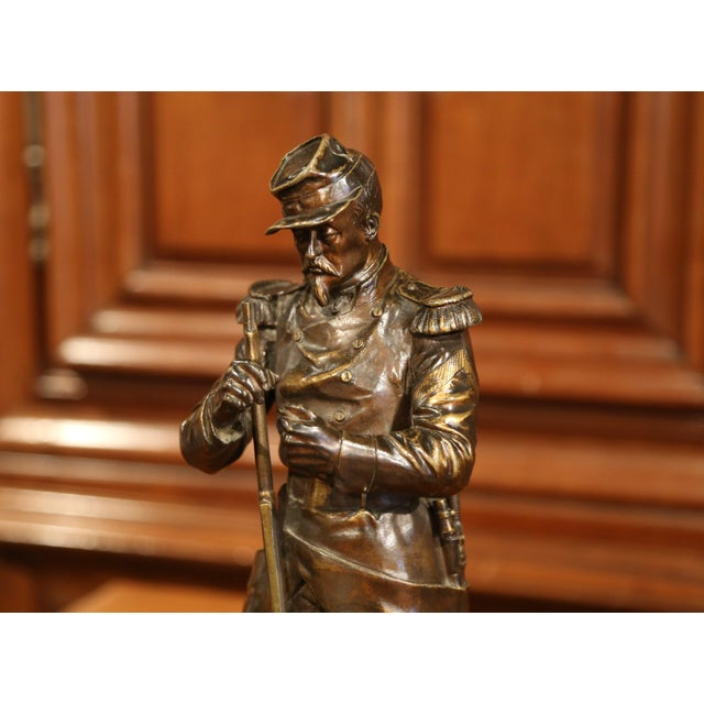 This beautifully detailed bronze figure was sculpted in France, circa 1850. The figural sculpture shows a French soldier...