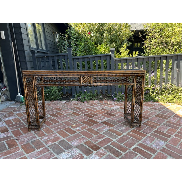 Antique Bamboo Chinoiserie with handmade Rattan Fretwork in original condition. This unique piece would make a great entry...