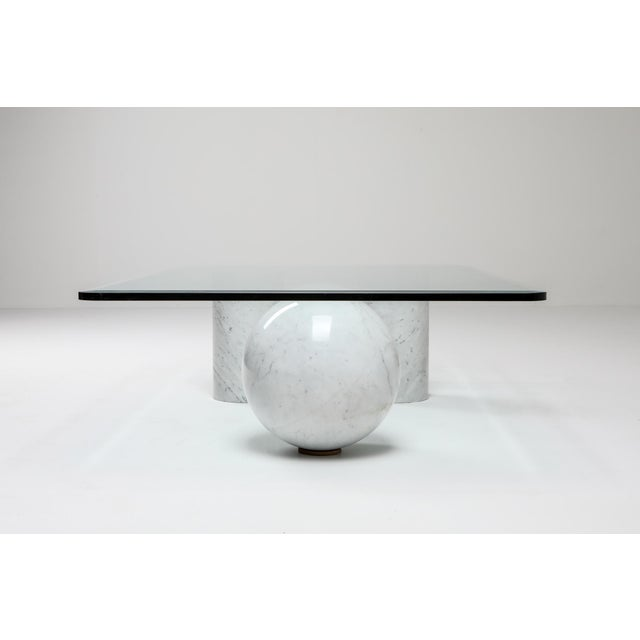 Post-modern Italian coffee table designed by Massimo Vignelli for Casigliani. This features a marble sphere and two...