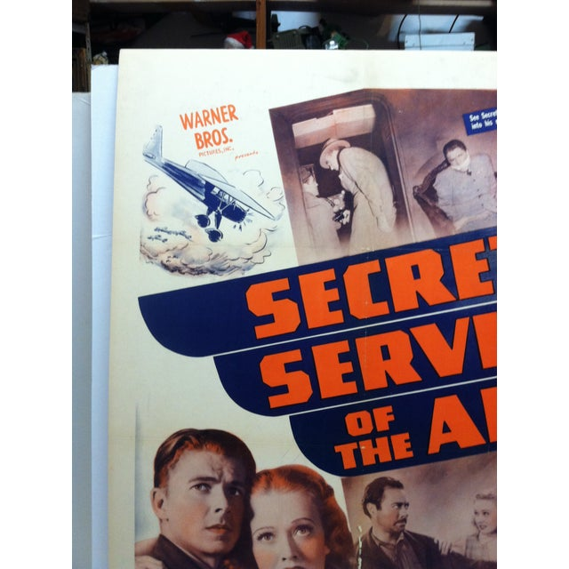 """This is a Vintage Mounted Movie Poster that is titled """"Secret Service Of The Air"""" starring Ronald Reagan. The Movie was..."""