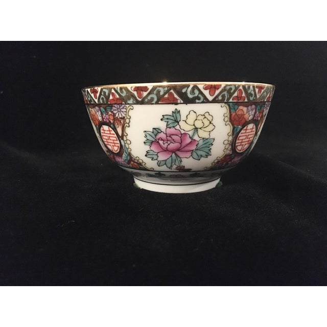 Lovely small decorative rice bowl in vibrant shades of red, pinks, purples. The detail is stunning on this piece, and it...