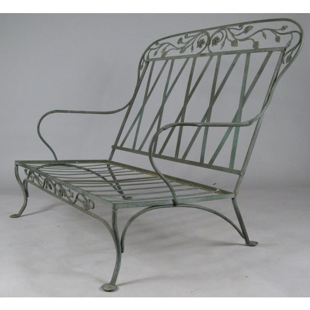 A gorgeous pair of large wrought iron settees circa 1950, by Salterini, in their blooming rose pattern. beautiful scale...