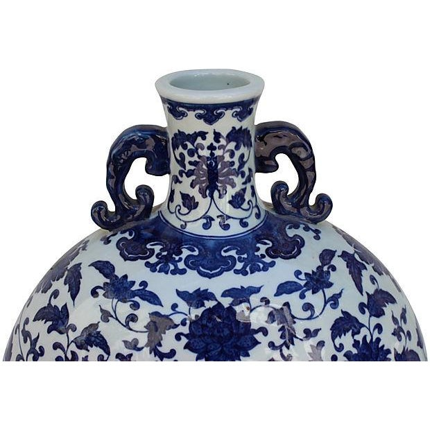 Asian Chinoiserie blue and white floral handle water vase. Made by the Yao hill tribe of Hunan province. Some wear.