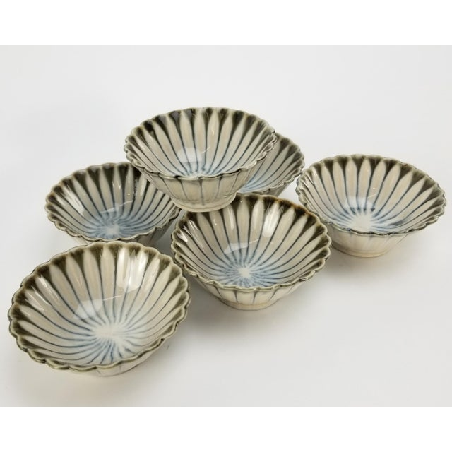 This is a gorgeous set of delicate Japanese soy sauce cups. The edges of the cups are scalloped and each scallop has a...
