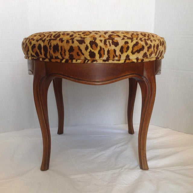 Elegantly fashioned fine Provincial style with dramatic faux leopard upholstery.