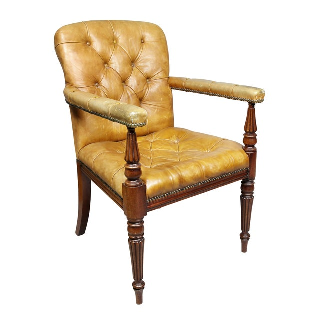 Comprising eighteen side and two armchairs, each with tufted brown leather upholstery raised on tapered circular tapered...