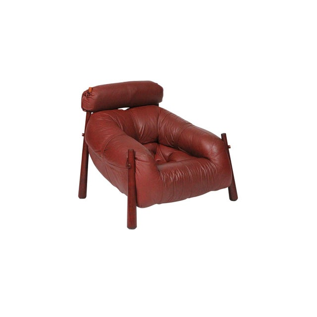 Sculptural lounge chair in exotic wood and brown leather by Brazilian designer Percival Lafer.