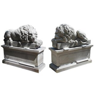 "Pair of Large Carved Stone Lions on Pedestals, ""The Sleeping and The Vigilant"" For Sale"
