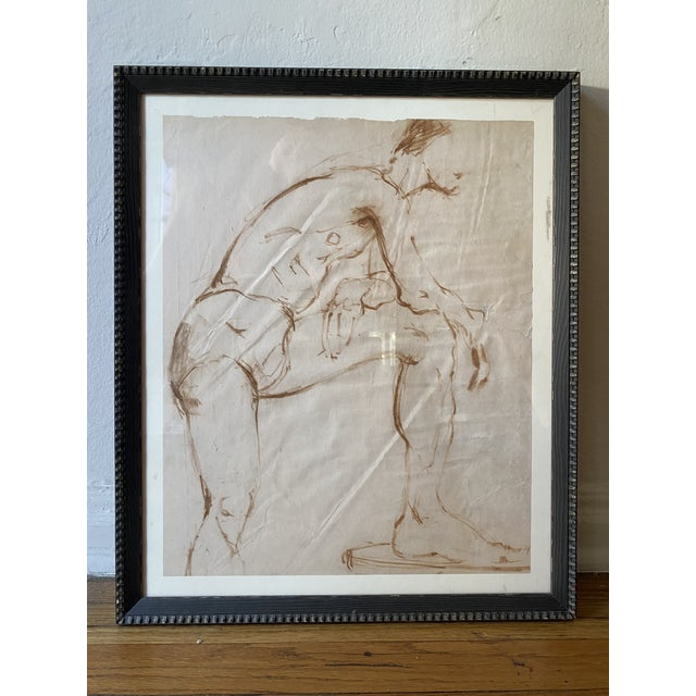 Oxblood colored nude portrait of a man, unsigned, framed by Allan Jefferies Framing. Purchased with a collection of Helen...