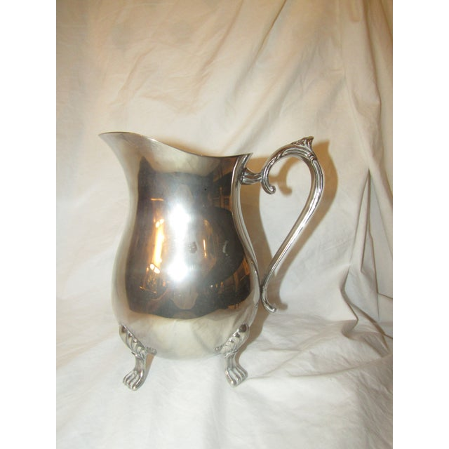Made by Leonard, silverplated and with formed handle and feet this water (or tea) pitcher is not only attractive but...