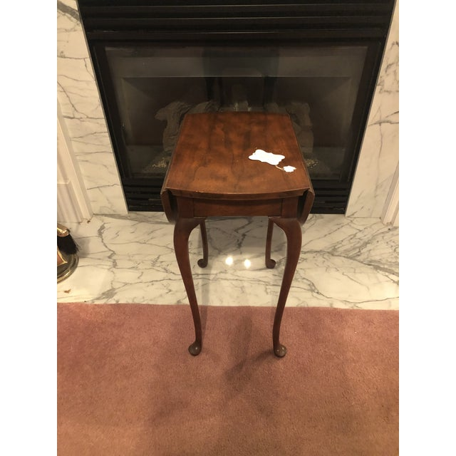 Small mahogany baker drop leaf table. Immaculate condition. Made in the 1970s.