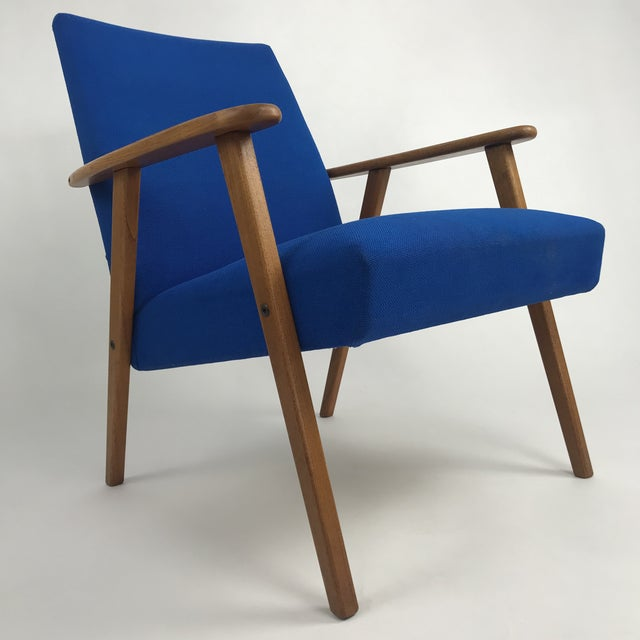Swedish modern lounge chair in original royal blue fabric. The frame is made of solid teak wood. This a great chair for...