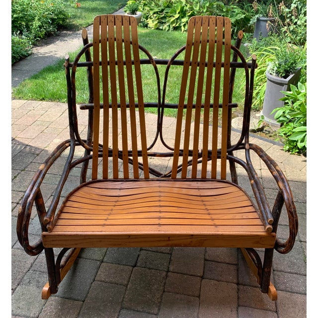 Fabulous vintage bentwood oak and twig Adirondack double rocking chair. Oak slats on back and seat are curved for maximum...