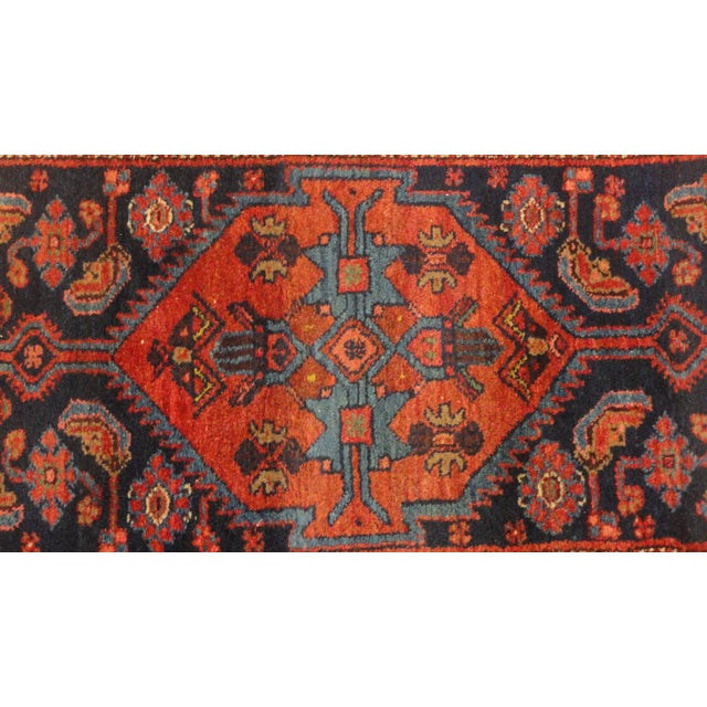 Add some ethnic elegance to your entryway or hall with this antique Persian Bijar runner rug. It was handmade in rich,...