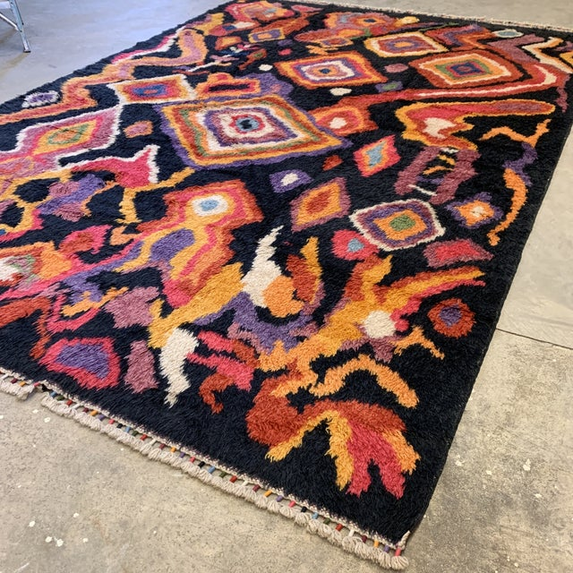 Super cool handmade Turkish shag rug in a multitude of colors on black background. Very Boho and Mod in style. Perfect...