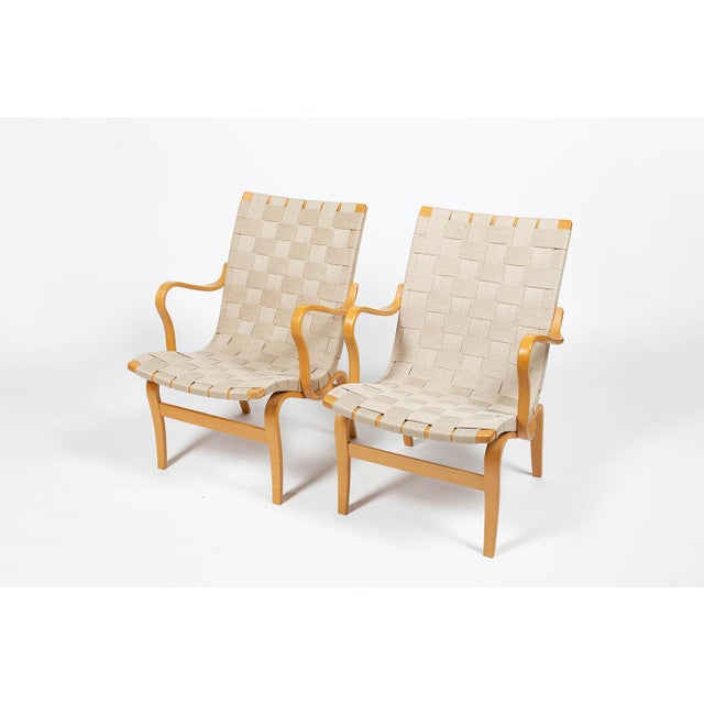 Wonderful 'Eva' armchairs by Bruno Mathsson for DUX, designed in 1941, produced circa 1970' in birch bentwood with hemp...