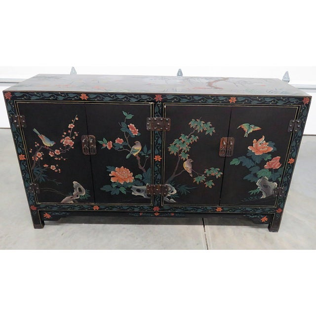 Asian paint decorated cabinet with 4 doors and 2 shelves.