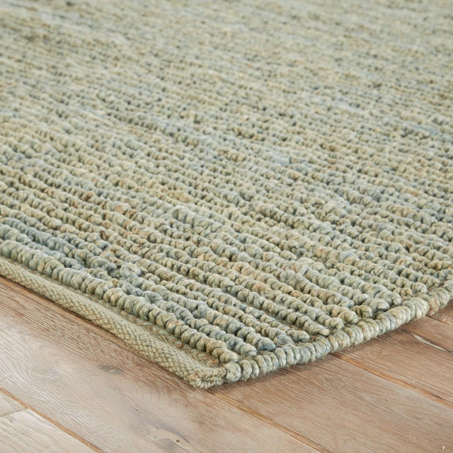This coastal style natural area rug offers versatile and organic allure to transitional spaces. Made of jute fibers, this...