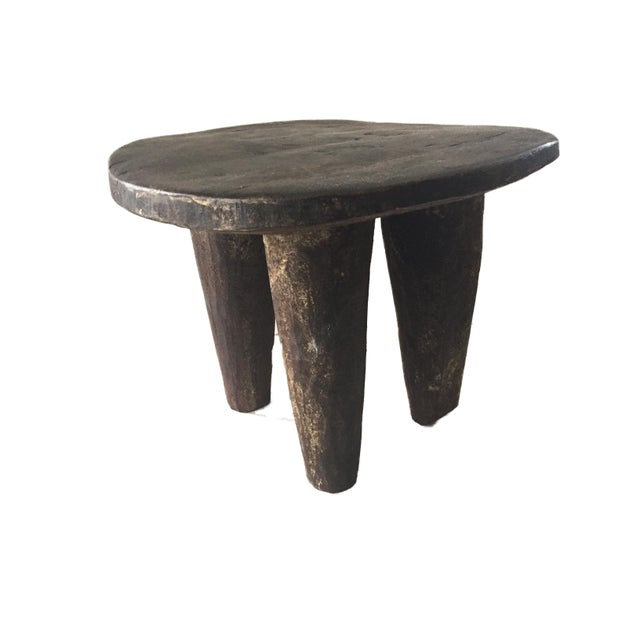 Superb African Senufo kids milk stool on four tapered legs with an abstract form . Carved from one piece of wood. Minor...