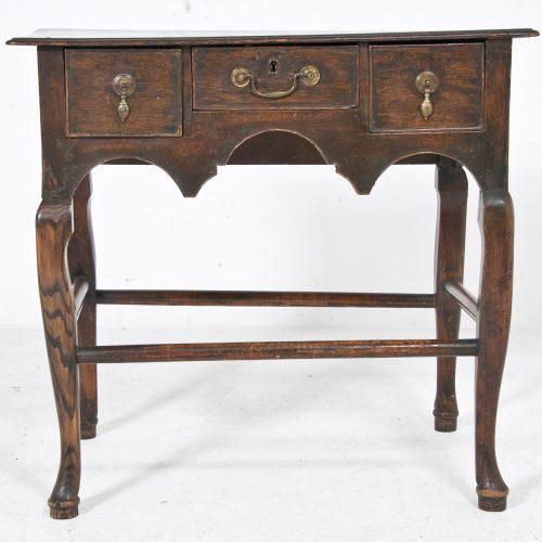 Early 20th Century English three drawer table on cabriole legs with stretchers. A classic design found in English and...