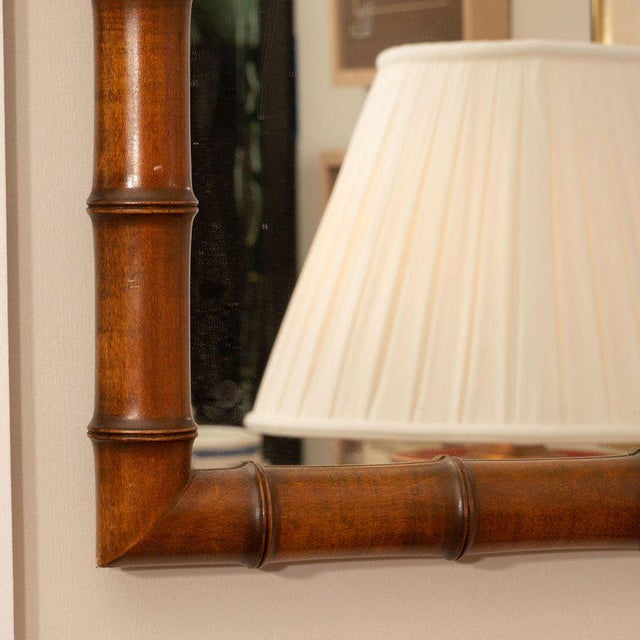 A nice looking faux bamboo rectangular mirror with great coloring and scale. This piece would fit the bill in a study,...