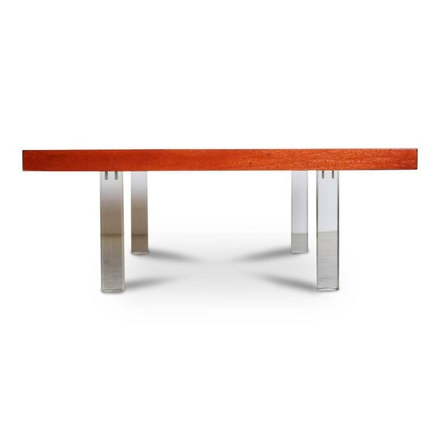 Stunning Milo Baughman coffee or cocktail table by Directional. The top is fabricated from solid walnut that displays a...