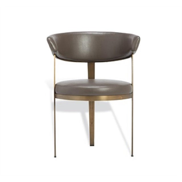 Sleek and chic dining chair in faux dark gray leather and steel legs in bronze. Two available.