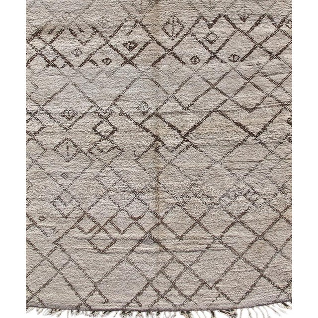 Characteristically plush wool from the Middle Atlas Mountains region of Morocco was used by the Berber weaver of this...