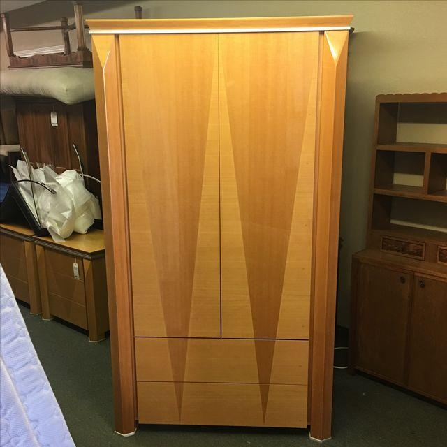 Design Plus Consignment Gallery has a Armoire from the Giorgio Collection. Made in Italy, this high-gloss armoire offers...