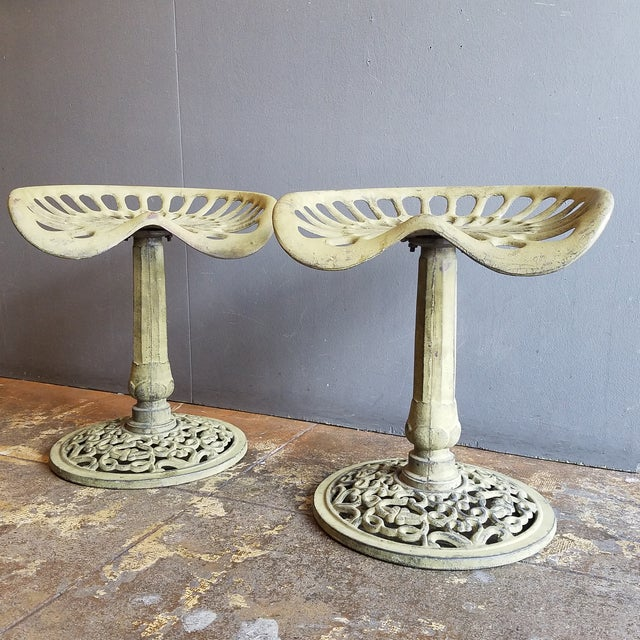 A pair of amazing cast iron metal tractor vintage stools for outdoor or indoors, heavy duty construction. Nice design ,...