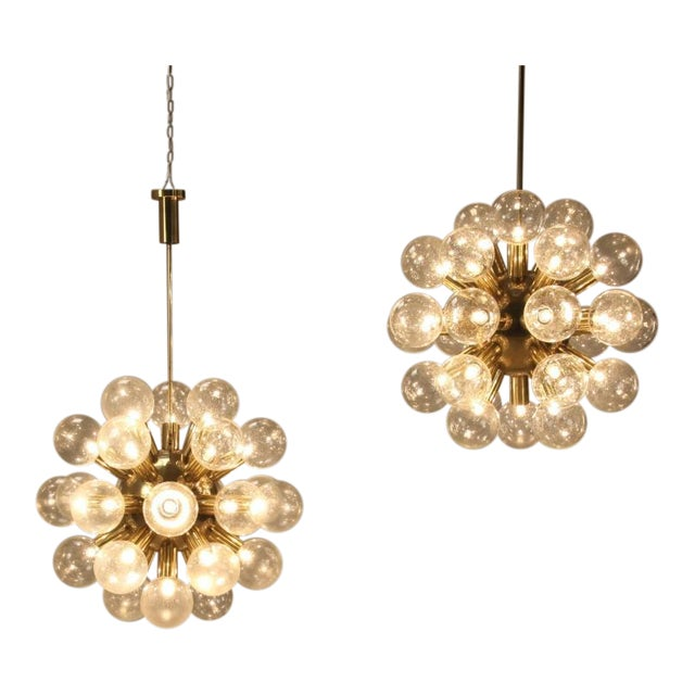 Amazingextra large Sputnik lamps by Robert Haussmann in excellent condition. Brass base with twenty eight light bulbs on...
