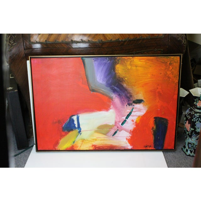 Brilliant abstract oil on canvas scene in red, yellow, blue, and gray, signed M. Caldwell. In thin black frame.