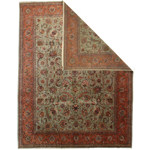Fine quality Persian Tabriz featuring a deep, green-color background and traditional stylings.