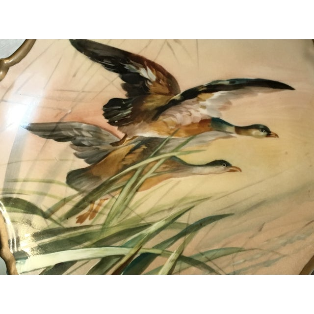 Lovely French Limoges Game Plate, Hand Painted & Signed. Design of Birds in flight amongst the foliage. Highly Scalloped...