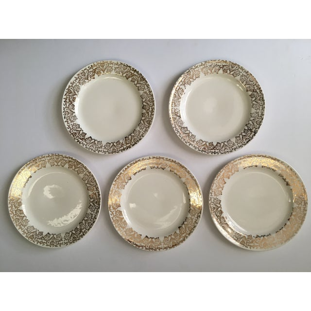 This set of 5 salad sized plates are marked Edwin M Knowles China Co. They are free of chips or cracks, but 2 do show...