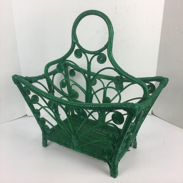 This is a vintage wicker rattan boho magazine rack from the 1960s. The piece has a divider in the middle and can be...