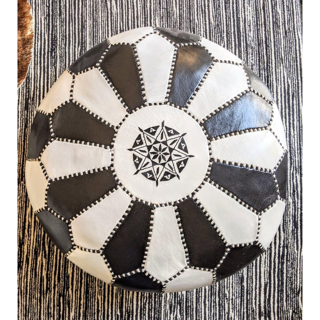 A striking, round leather ottoman handmade in Morocco. Tooled and embroidered using traditional techniques, this high-...