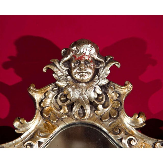 Pair of French Rococo style girandoles, late 19th century. Feature a fine silver-gilt and are elegantly decorated with...