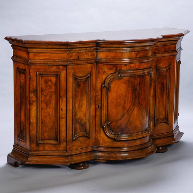 Circa 1860s burl walnut cabinet with rounded front and locking storage compartments. Nicely figured walnut with curvy,...