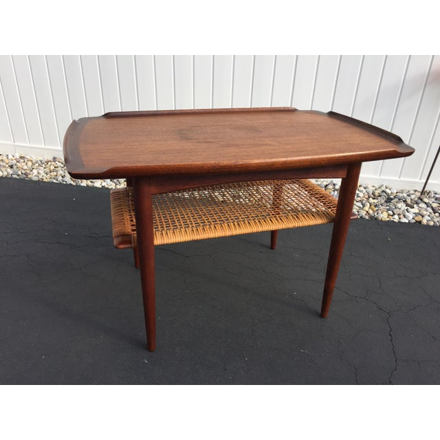 Mid century Danish modern design illustrated by this beautiful walnut side table. Table was created by Poul Jensen for...