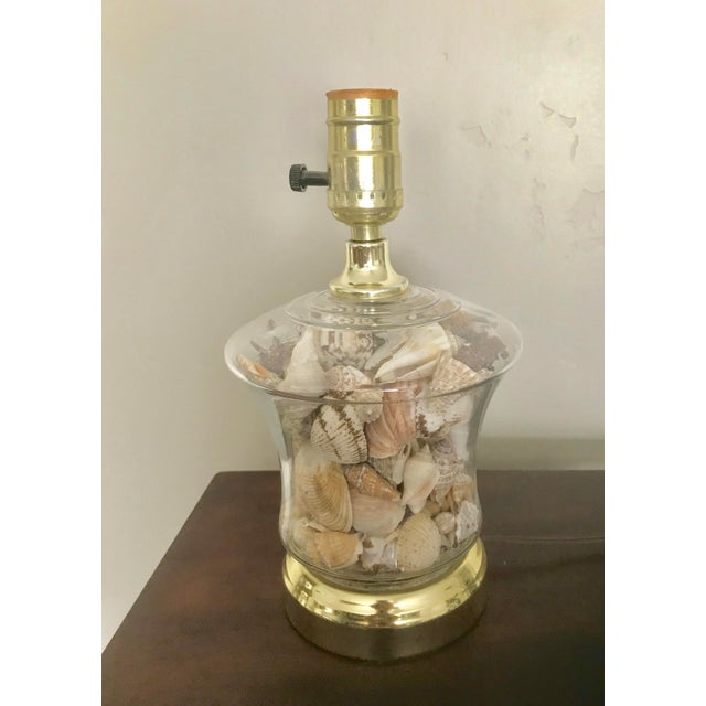 Filled with lots of shells, this vintage lamp is a great addition to a child's bedroom or an office! Pick your own...