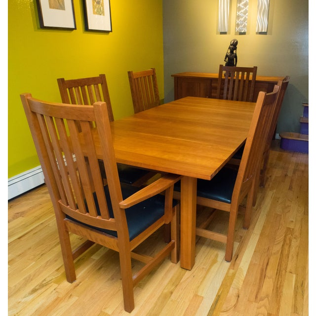 This stunning dining room set features very elegant, straight, lines, typical of Shaker-Style designs, and impeccable...