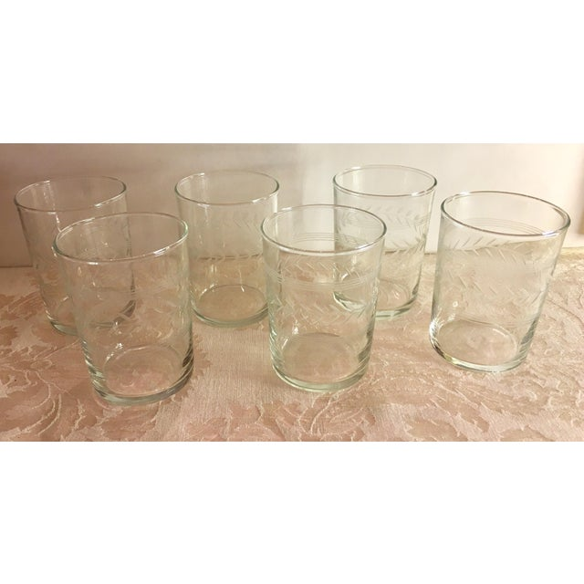 Nice set of Mid-Century etched glass juice glasses. Nice design.