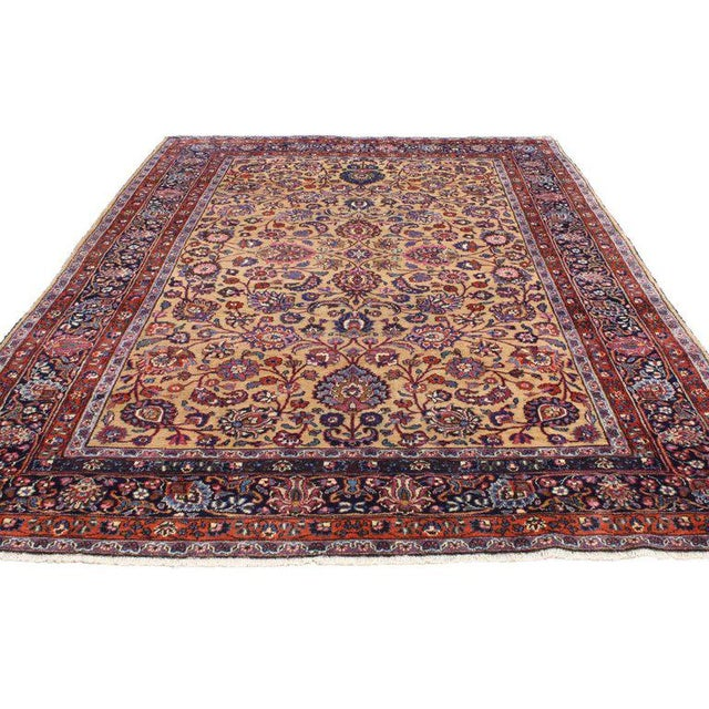 76808 Antique Persian Mashhad Rug with Traditional Style 06'09 x 10'04. With its ornate floral detailing and rich colors,...