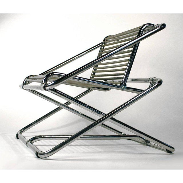 A rare chrome-plated bent tubular steel rocking chair with PVC-covered galvanized springs. Manufactured by One Off, Ltd.,...