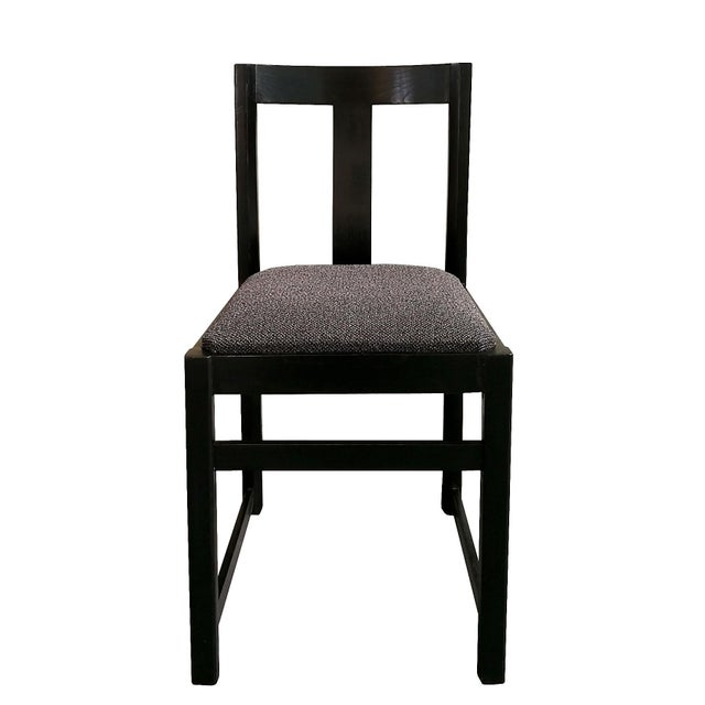 Set of four chairs, stained and waxed ashwood, new seat upholstered with a loop pile fabric. In the style of Alfons Milà....