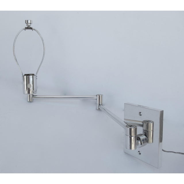 Vintage: C. 1970s Georg Hanson for Hanson Lighting Co., chrome-plated over steel , swing-arm wall sconce, made by...
